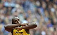 Jamaica&#39;s Usain Bolt gestures before the men&#39;s 200m heats at the athletics event during the London 2012 Olympic Games on August 7, in London