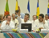 <p>Ecuador President Rafael Correa (C) speaks next to the foreign ministers of Ecuador, Ricardo Patino, (L) and Venezuela, Nicolas Maduro, (R) during an extraordinary meeting of the Bolivarian Alliance for the Peoples of Our America (ALBA) in Guayaquil, Ecuador on August 18, to discuss Ecuador's political clash with Britain over its decision to grant asylum to Wikileaks founder Julian Assange</p>