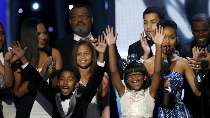 "Brown and Martin celebrate with other cast members after their series ""black-ish"" won the award for Outstanding Comedy Series at the 47th NAACP Image Awards in Pasadena"
