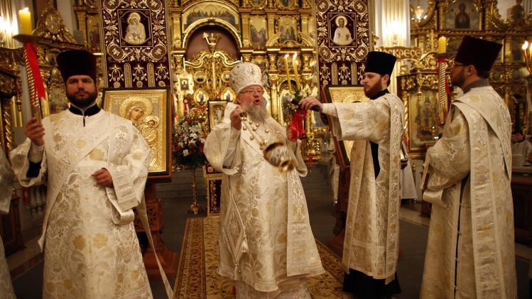 A Ukrainian Orthodox priest conducts a holy liturgy during an Orthodox Easter service in Donetsk