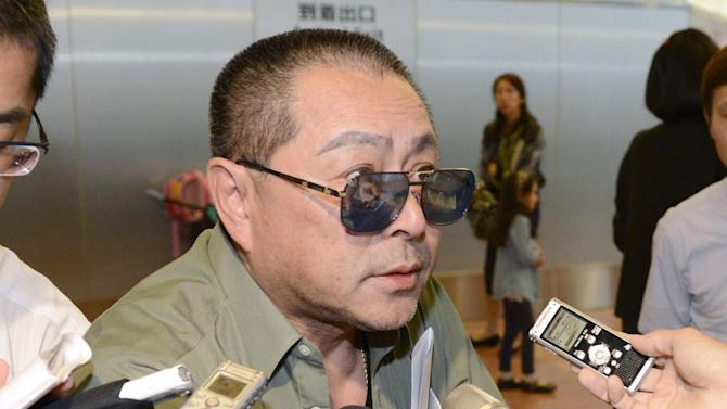 """In this Sept. 15, 2012 photo, Kenji Fujimoto, the late North Korean leader Kim Jong Il's personal sushi chef from 1988-2001, is interviewed upon his arrival in Tokyo after visiting Pyongyang. Fujimoto said Thursday, Dec. 6, he believes the late leader's son and successor, Kim Jong Un, was backing North Korea's planned launch of a long-range rocket this month to show respect for his father. """"I don't think that Kim Jong Un is taking a very aggressive role in pushing for this launch, but he might want to commemorate his father's passing,"""" Fujimoto said. (AP Photo/Kyodo News) JAPAN OUT, MANDATORY CREDIT, NO LICENSING IN CHINA, FRANCE, HONG KONG, JAPAN AND SOUTH KOREA"""