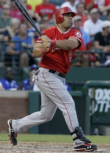 Morales hits 2 HRs in inning, Angels rout Texas