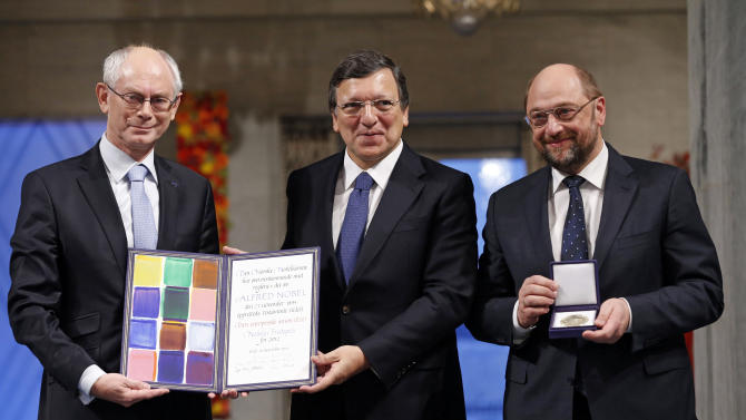 "From left, European Council President Herman Van Rompuy, European Commission President Jose Manuel Barroso and European Parliament President Martin Schulz with the Nobel diploma on the podium at the City Hall, Oslo, during the Nobel Peace Prize ceremony, Monday Dec. 10, 2012. The European Union has received this yearís Nobel Peace Prize in the Norwegian capital, for promoting ""peace and reconciliation, democracy and human rights"" in Europe for six decades following the tremendous devastation of World War II. (AP Photo/Cornelius Poppe/NTB Scanpix, Pool)"