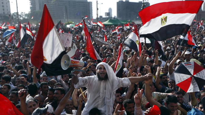 Egyptians celebrate the victory of Mohammed Morsi, in the presidential elections, in Tahrir Square, Cairo, Egypt, Sunday, June 24, 2012. Morsi was declared Egypt's first Islamist president on Sunday after the freest elections in the country's history, narrowly defeating Hosni Mubarak's last Prime Minister Ahmed Shafiq in a race that raised political tensions in Egypt to a fever pitch. (AP Photo/Khalil Hamra)