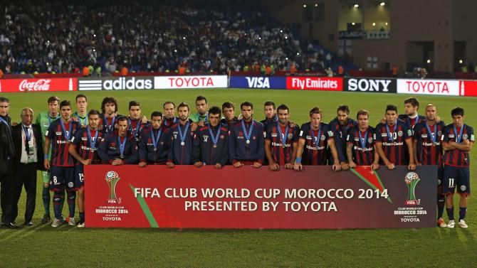 San Lorenzo team pose after being defeated by Real Madrid in their Club World Cup final soccer match at Marrakesh stadium