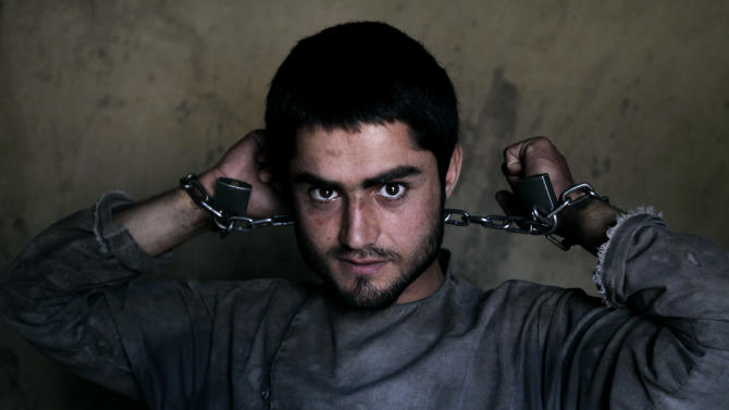 AP10ThingsToSee - Amanullah , 20, a drug addict, is chained to a wall during his 40-day incarceration at the Mia Ali Baba shrine in Jalalabad, Afghanistan, Saturday, June 1, 2013. It is believed locally that 40 days chained to a wall and with a restricted diet of only water, black pepper and bread at the 300-year old shrine can cure the mentally ill, drug addicts and those possessed by spirits. If a shrine keeper decides their situation is improving, they may be unchained for a few minutes so they can pray, walk outside or visit a proper bathroom. (AP Photo/Rahmat Gul, File)
