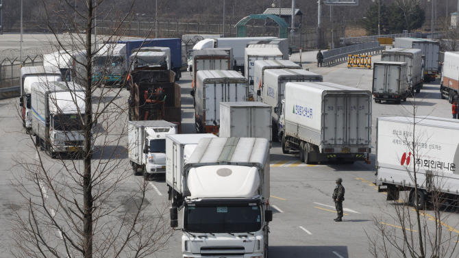 South Korean vehicles turn back their way as they were refused for entry to North Korea's city of Kaesong, at the customs, immigration and quarantine office in Paju, South Korea, near the border village of Panmunjom, Wednesday, April 3, 2013.  North Korea on Wednesday barred South Korean workers from entering a jointly run factory park just over the heavily armed border in the North, officials in Seoul said, a day after Pyongyang announced it would restart its long-shuttered plutonium reactor and increase production of nuclear weapons material. (AP Photo/Ahn Young-joon)