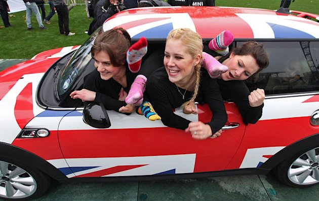 A Mini Cooper stuffed with 28 agile women