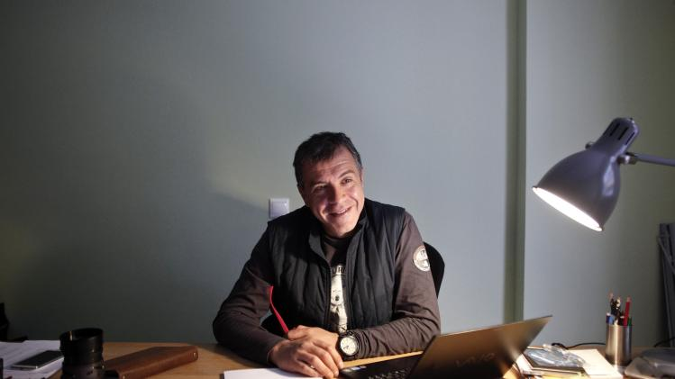 Stavros Theodorakis smiles during an interview with Reuters in Athens
