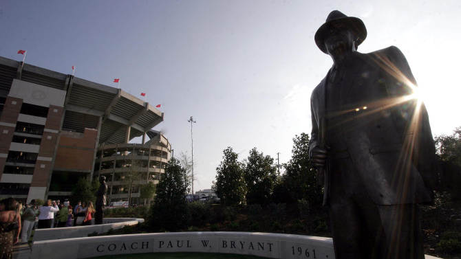"FILE - In this Aug. 31, 2006, file photo, the late-afternoon sun shines off a statue of Paul ""Bear"" Bryant during the grand opening of the newly-remodeled Bryant-Denny Stadium at the University of Alabama in Tuscaloosa, Ala. (AP Photo/Tuscaloosa News, Michelle Williams, File)"