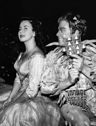"FILE - In this July 27, 1959 file picture Swiss opera singer Lisa della Casa , left, performs with Austrian singer Walter Berry during a dress rehearsal of Wolfgang Amadeus' opera ""Die Zauberfloete"" (""The Magic Flute"") at the Salzburger Festspiele in Salzburg, Austria. According to media reports on Tuesday, Dec. 11, 2012, Lisa della Casa died at the age of 93 at Muensterlingen at the Lake of Constance, Switzerland. (AP Photo/Keystone/Str, File) NO ARCHIVE"