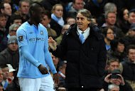 Manchester City&#39;s Mario Balotelli (L) shares a joke with manager Roberto Mancini when coming on as a substitute during the FA Cup third-round clash against Watford on January 5, 2013. Mancini admitted he will be disappointed to see &quot;one of my children&quot; Balotelli leave Manchester for AC Milan but insists the move is in the best interests of the Italy forward