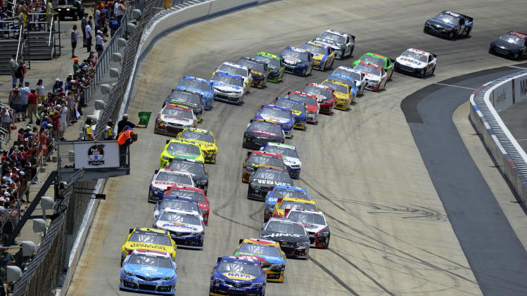 Racers take the green flag for the start of a NASCAR Sprint Cup Series auto race Sunday, June 2, 2013, at Dover International Speedway in Dover, Del. (AP Photo/Nick Wass)