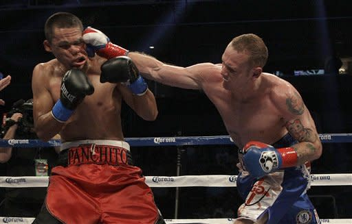 George Groves, from England, right, knocks out Francisco Sierra during the sixth round of a light heavyweight fight in San Jose, Calif., Saturday, July 28, 2012. (AP Photo/Jeff Chiu)