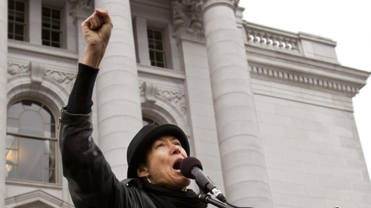 FILE - In this March 5, 2011 file photo shows alternative folk and rock singer Michelle Shocked performing for a crowd at the state Capitol in Madison, Wis. Shocked has had several shows canceled after making an anti-gay slur at a concert in San Francisco. (AP Photo/Andy Manis, file)