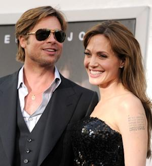 "Brad Pitt and Angelina Jolie arrive at the premiere of ""Salt"" in Hollywood, California on July 19, 2010 -- Getty Images"