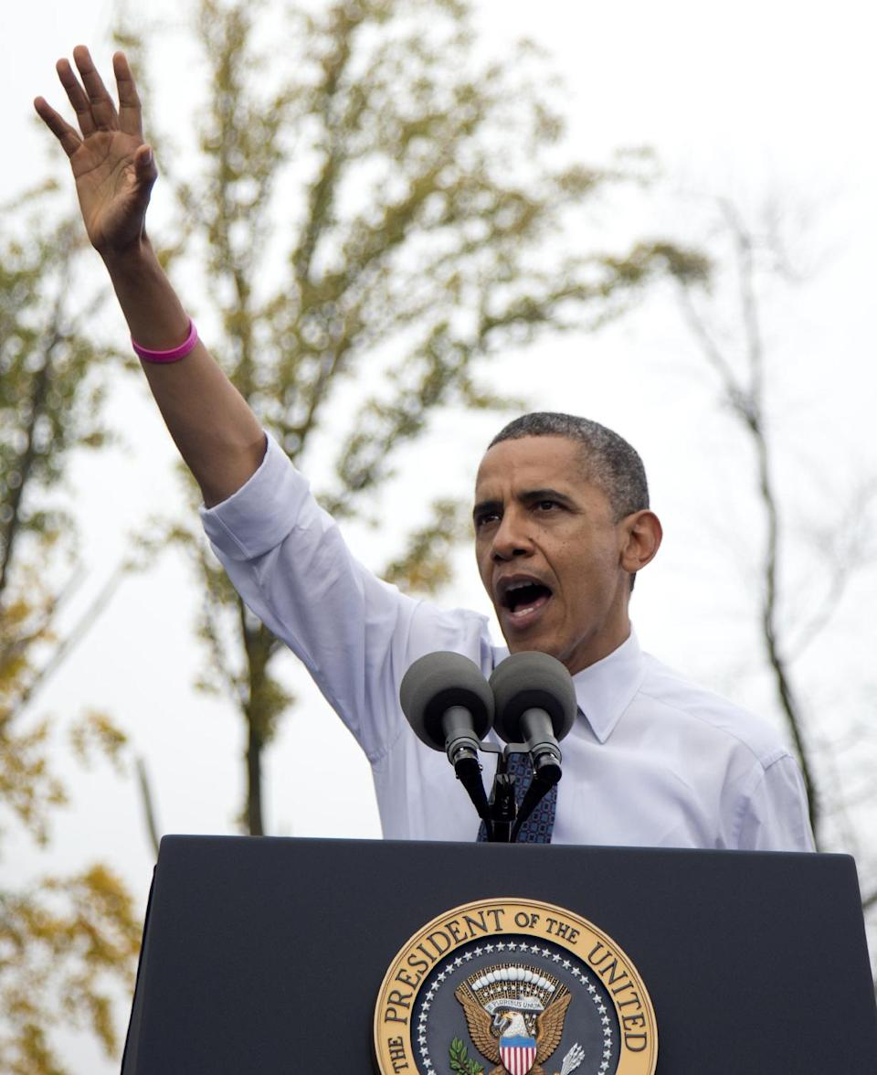 President Barack Obama gestures while speaking about the choice facing women in the upcoming election, Friday, Oct. 19, 2012, at a campaign event at George Mason University in Fairfax, Va. (AP Photo/Carolyn Kaster)