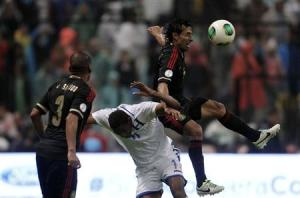 Mexico's Arce jumps for the ball against Honduras' Bengtson as Mexico's Salcido looks on during their 2014 World Cup qualifying soccer match in Mexico City