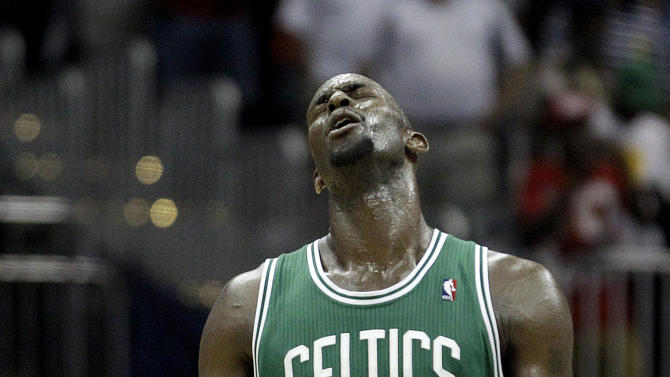 Boston Celtics' Kevin Garnett reacts after teammate Rajon Rondo was ejected for during the fourth quarter of Game 1 of an opening-round NBA basketball playoff series against the Atlanta Hawks on Sunday, April 29, 2012, in Atlanta. Atlanta won 83-74. (AP Photo/David Goldman)