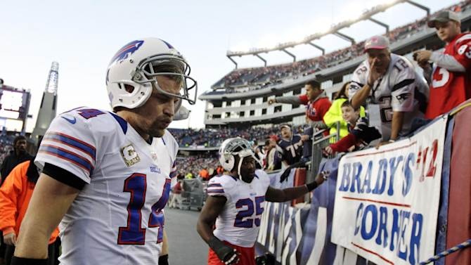 Buffalo Bills quarterback Ryan Fitzpatrick (14) walks off the field after their 37-31 loss to the New England Patriots in an NFL football game at Gillette Stadium, in Foxborough, Mass., Sunday, Nov. 11, 2012. (AP Photo/Steven Senne)