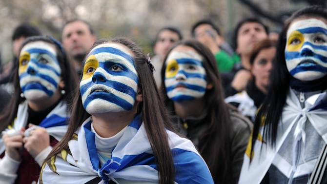 Uruguay fans react during the live broadcasting of the FIFA World Cup Round of 16 match against Colombia in Montevideo, on June 28, 2014