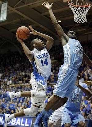 Duke's Rasheed Sulaimon (14) drives to the basket as North Carolina's Reggie Bullock (35) defends during the first half of an NCAA college basketball game in Durham, N.C., Wednesday, Feb. 13, 2013. (AP Photo/Gerry Broome)