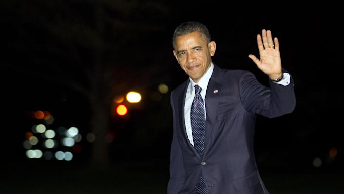 President Barack Obama waves as he arrives on the South Lawn of the White House after returning from Korea on Tuesday, March 27, 2012, in Washington.  (AP Photo/Evan Vucci)