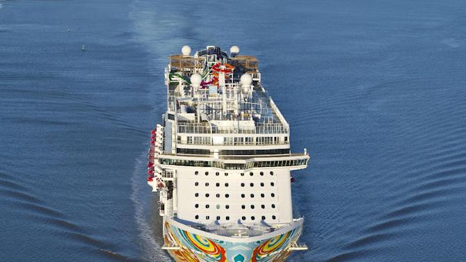 """This Nov. 2013 image provided by Norwegian Cruise Line shows the Norwegian Getaway during its debut. It will homeport in Miami and its colorful exterior was designed by Miami-based Cuban-American artist David Le Batard, also known as """"LEBO."""" Getaway is a sister ship to Norwegian Breakaway, which debuted in 2013 with a New York theme and homeports from Manhattan. (AP Photo/ Norwegian Cruise Line)"""