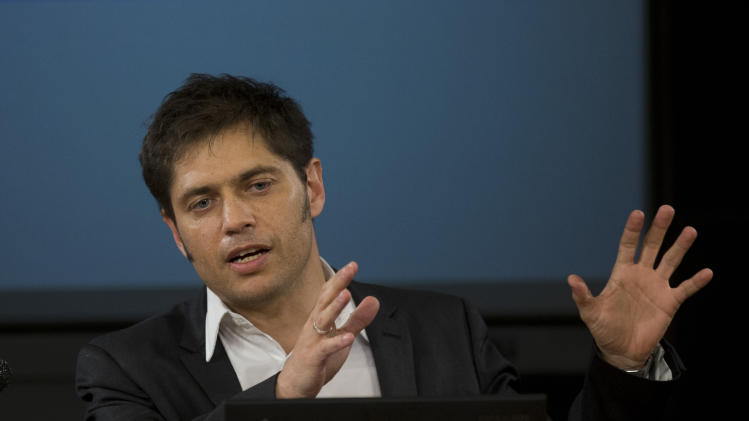 Argentina's Economy MInister Axel Kicillof talks to the media at a press conference to explain the recent U.S. Supreme Court's ruling on Argentina's bond default, in Buenos Aires, Argentina, Tuesday, June 17, 2014. The Argentine economy minister says the government is working on a debt swap that would make payments in Argentina to creditors who accepted previous debt restructurings. (AP Photo/Eduardo Di Baia)