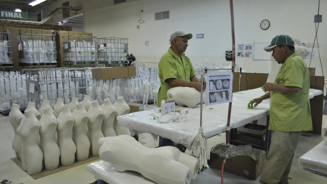 FILE - In this Jan. 13, 2011 file photo, workers produce mannequins at the Tecma Group, which operates 18 maquiladoras, or assembly-for-export plants, for 33 companies in the northern border city of Ciudad Juarez, Mexico. Mexico's Senate is debating President Enrique Pena Nieto's proposed tax reform, a measure that business leaders warn could threaten border assembly plants known as maquiladoras, that have long received tax breaks that would be curtailed under the proposed tax changes. The plants are the lifeblood of border cities such as Ciudad Juarez, which are just recovering from a three-year wave of brutal drug-gang killings. (AP Photo/Raymundo Ruiz, File)