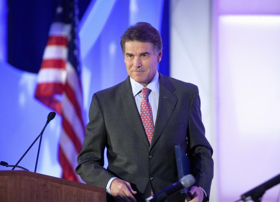 Republican presidential candidate, Texas Gov. Rick Perry leaves to podium after a speech at the Georgia Legislative Briefing, Friday, Sept. 30, 2011, in Atlanta. (AP Photo/David Goldman)