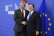 Canadian Prime Minister Stephen Harper, left, shakes hands with President of the European Commission Jose Manuel Barroso as they meet in Brussels on Friday Oct. 18, 2013. THE CANADIAN PRESS/Adrian Wyld