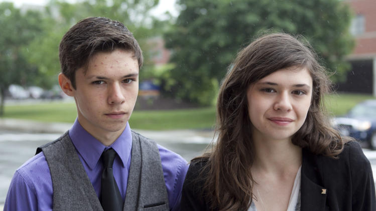 Jonas Maines, left, and his transgender sister, Nicole Maines, stand outside the Penobscot Judicial Center, Wednesday, June 12, 2013, in Bangor, Maine. The siblings were born as identical twins boys. The state supreme court heard arguments on Wednesday over a school district's handling of Nicole Maine's restroom needs. The lawsuit accuses the school district of breaking a state law in 2007 when it stopped letting the Maines use the girls bathroom and required to her use a staff bathroom after a student's grandfather complained. (AP Photo/Robert F. Bukaty)