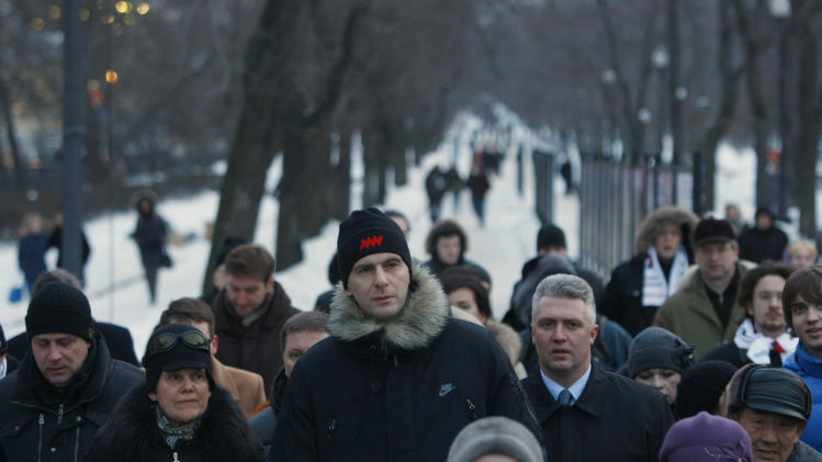 "Russian Presidential candidate and billionaire Mikhail Prokhorov, center, heads to a protest rally in downtown Moscow, Monday, March 5, 2012. A protest rally has been set for Monday evening on Moscow's iconic Pushkin Square, where some 12,000 police have deployed to ensure order. There were ""serious problems"" in the vote that returned Vladimir Putin to the Russian presidency, the head of the major international election observer mission said Monday, adding fuel to an opposition testing its strength with plans for a massive protest rally. (AP Photo/Alexander Zemlianichenko)"