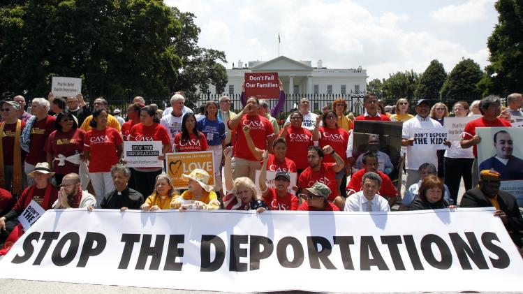 Church groups take part in a protest against President Barack Obama's immigration enforcement policies outside the White House in Washington
