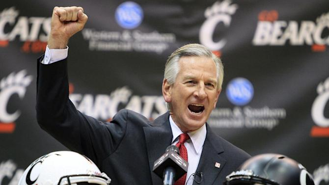 Tommy Tuberville pumps his fist as he was introduced as the new head football coach at the University of Cincinnati, Saturday, Dec. 8, 2012, in Cincinnati. Tuberville had been head coach at Texas Tech, and previously at Auburn and Mississippi. (AP Photo/Al Behrman)