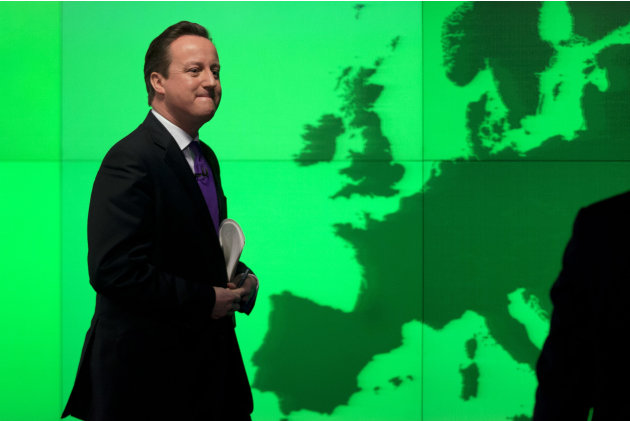 Britain's Prime Minister David Cameron walks past a map of Europe on a screen as he walks away after making a speech on holding a referendum on staying in the European Union in London, Wednesday, Jan.