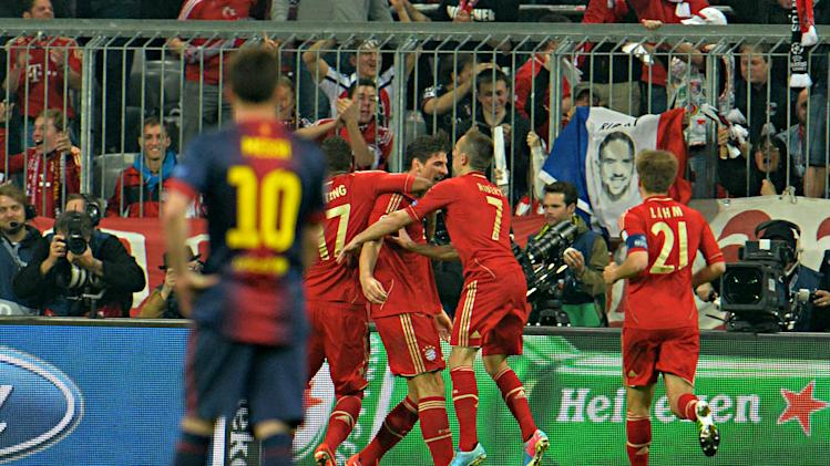 Barcelona forward Lionel Messi, of Argentina,  looks at Bayern players celebrate after Mario Gomez, third right, scored during the Champions League semifinal first leg soccer match between Bayern Munich and FC Barcelona in Munich, Germany, Tuesday, April 23, 2013. (AP Photo/Kerstin Joensson)