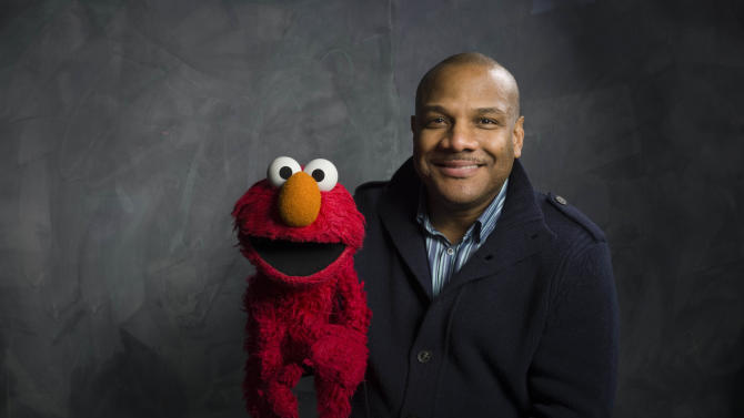 "FILE - This Jan. 24, 2011 file photo shows Elmo and puppeteer Kevin Clash of the film ""Being Elmo"" poses for a portrait in the Fender Music Lodge during the 2011 Sundance Film Festival in Park City, Utah. Clash who was the puppeteer and voice of Elmo on ""Sesame Street"" is being sued for the fifth time, accused of sexually abusing an underage youth. In a federal lawsuit filed in New York on Tuesday, April 2, 2013, 25-year-old Kevin Kiadii says he was 16 when he met Kevin Clash during an online chat. (AP Photo/Victoria Will, File)"
