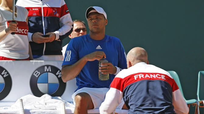 French tennis team captain Guy Forget, speaksto French  player Jo-Wilfried Tsonga during his match against U.S. player John Isner, in the quarterfinal of the Davis Cup between France and U.S. in Monaco Sunday April 8, 2012. John Isner won the match and qualifies the U.S. team for the semi-final.(AP Photo/Remy de la Mauviniere)