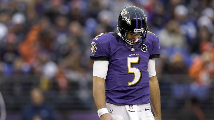 Baltimore Ravens quarterback Joe Flacco walks off the field with his head down during the second half of an NFL football game against the Denver Broncos in Baltimore, Sunday, Dec. 16, 2012. (AP Photo/Patrick Semansky)