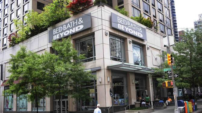 A passerby walks in front of a Bed, Bath, and Beyond in New York