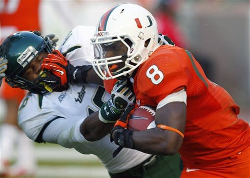 Morris throws for 413, Miami rolls past USF 40-9
