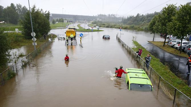 Submerged vehicles are seen following heavy rains in Lorenskog