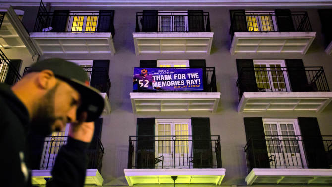 A banner hangs from a balcony on Bourbon Street in tribute to Baltimore Ravens linebacker Ray Lewis, who is retiring as a player after Sunday's NFL football Super Bowl football game between the San Francisco 49ers and the Ravens, Friday, Feb. 1, 2013, in New Orleans. (AP Photo/David Goldman)