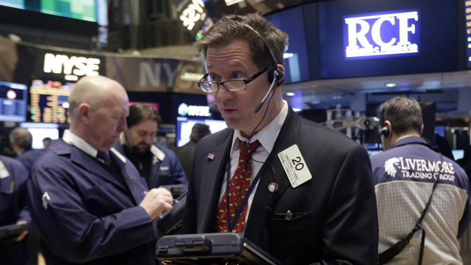 FILE - In this Wednesday, Feb. 26, 2014, file photo, Trader Christopher Forbes, center, works on the floor of the New York Stock Exchange. The stock market is little changed as investors pick over more earnings reports from retailers and other U.S. companies. (AP Photo/Richard Drew, File)
