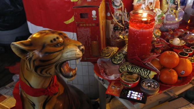 A smartphone is placed on a make-shift altar during Jingzhe in Hong Kong