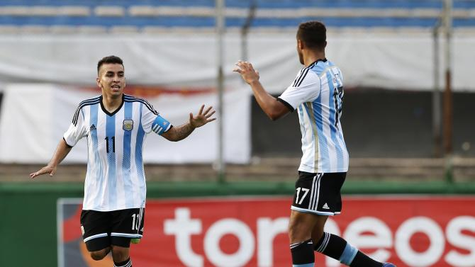Argentina's Correa celebrates with team mate Ibanez after scoring against Peru during their soccer match for the final round of the South American Under-20 Championship in Montevideo