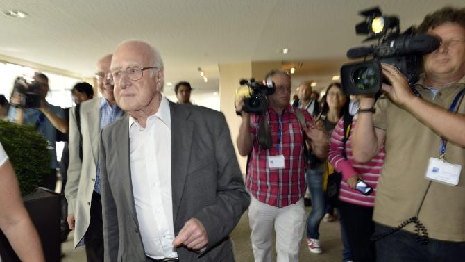 "British physicist Peter Higgs, left, arrives to hear about the latest update in the search for the Higgs boson at the European Organization for Nuclear Research (CERN) in Meyrin near Geneva, Switzerland, Wednesday, July 4, 2012. The head of the world's biggest atom smasher is claiming discovery of a new particle that he says is consistent with the long-sought Higgs boson known popularly as the ""God particle"" which is believed to give all matter in the universe size and shape. (AP Photo/Keystone/Martial Trezzini)"