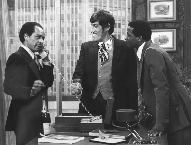 "FILE - In this 1977 file photo provided by CBS, from left, Sherman Hemsley, Paul Benedict, and Damon Evans star in an episode of ""The Jeffersons."" Hemsley, the actor who made the irascible, bigoted Ge"